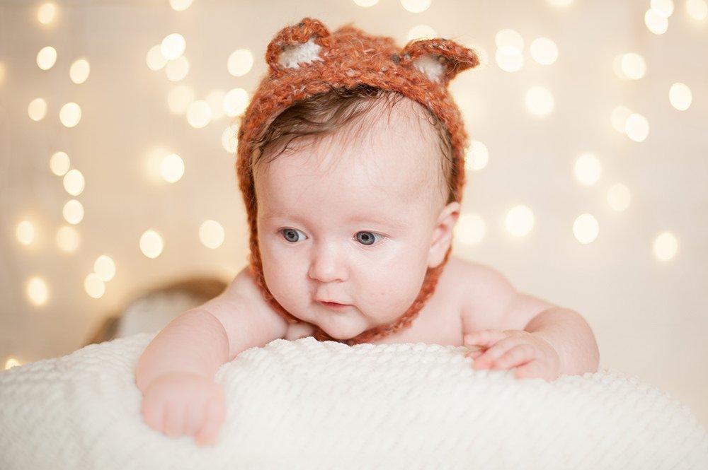 Baby photoshoot in Southampton wearing fox bonnet