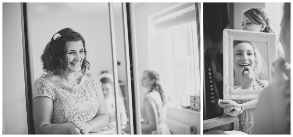 Black and white photo of Bride getting ready with mirrors at St Ives, Ringwood