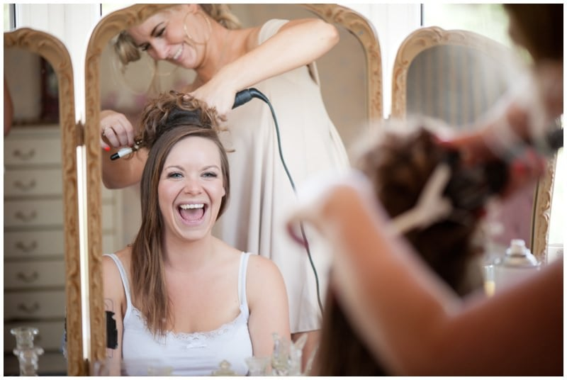 Ringwood Bride laughing with hairdresser on wedding day