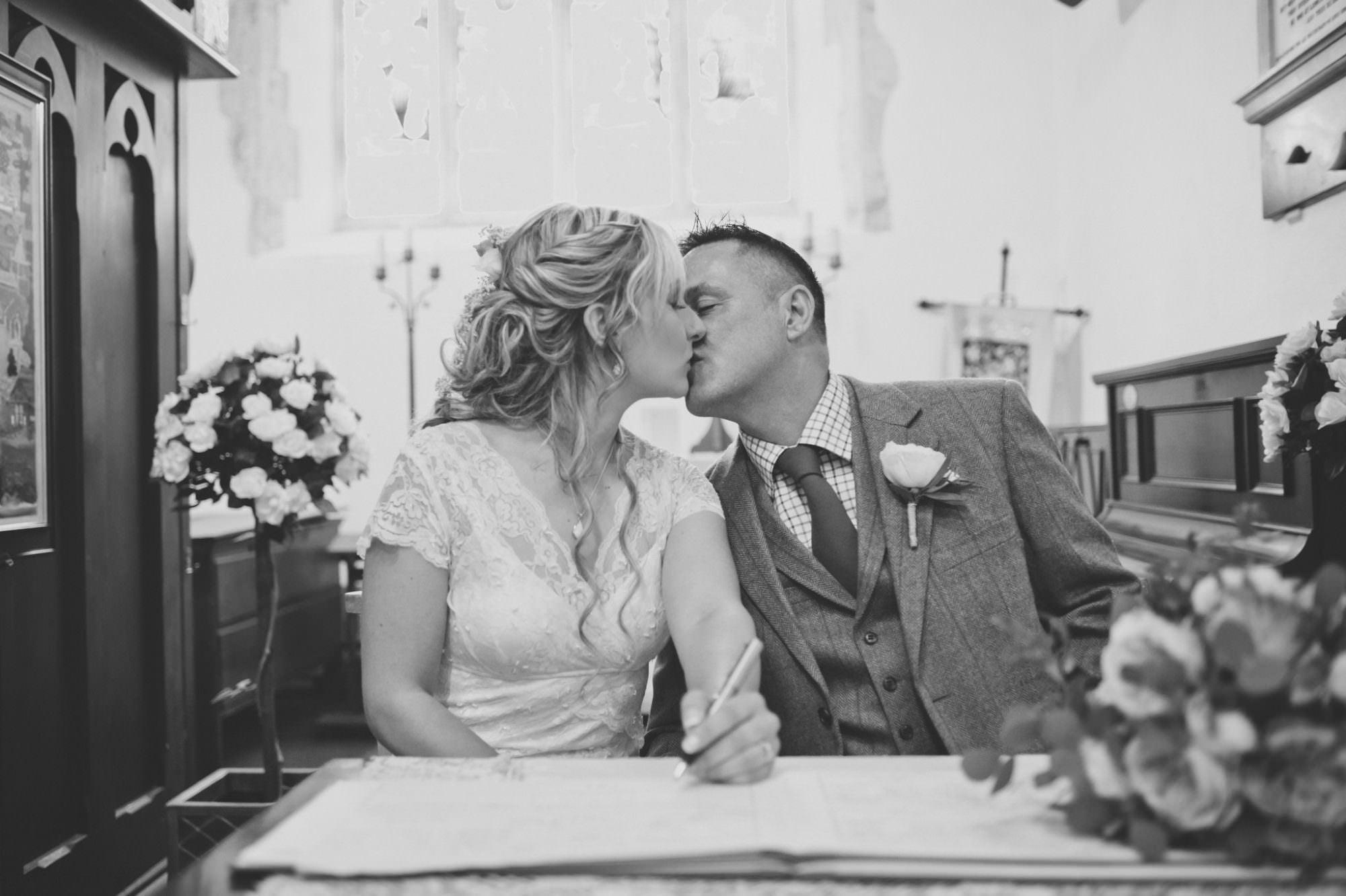 Signing wedding register at Sopley Church